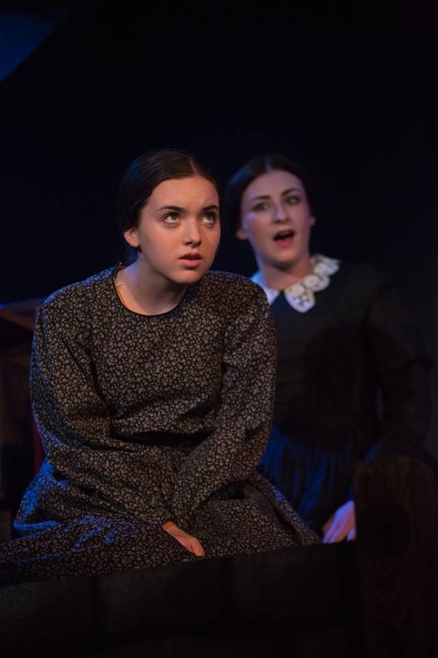 Girl acting in play as Jane Eyre.