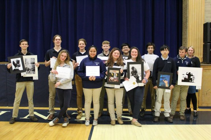 Students recognized at school for art awards.