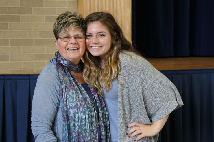 Girl and her grandmother pose together at Grandparents Day