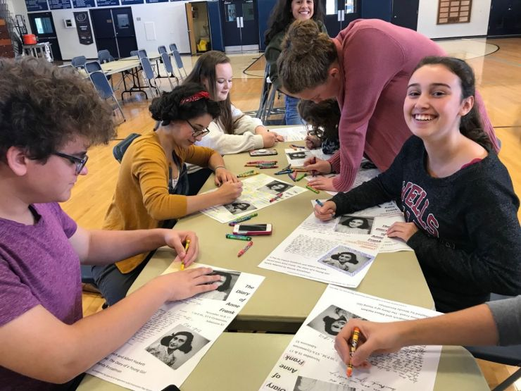 Students create posters for the Diary of Anne Frank play.
