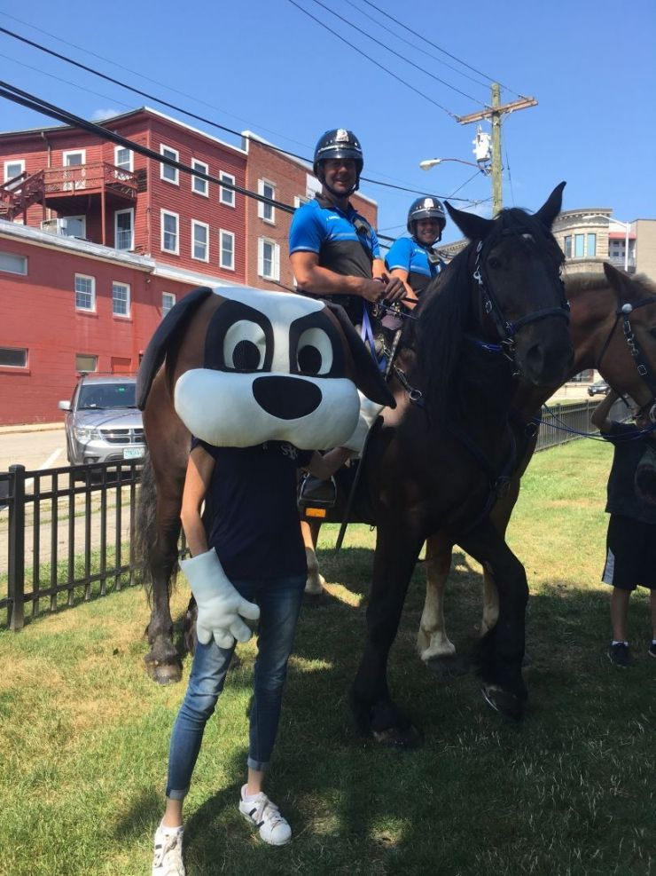 Mascot next to Mounted Patrol Officer