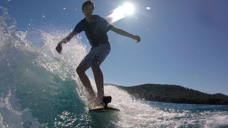 Boy watersurfing
